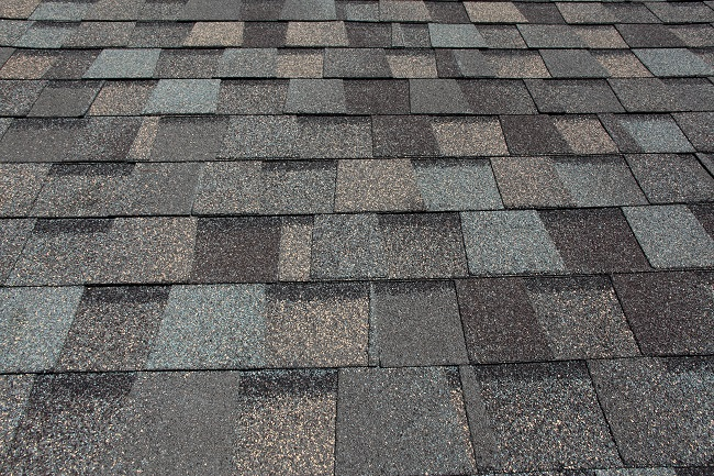 What Are Those Granules Coming Off Your Shingle Roof?